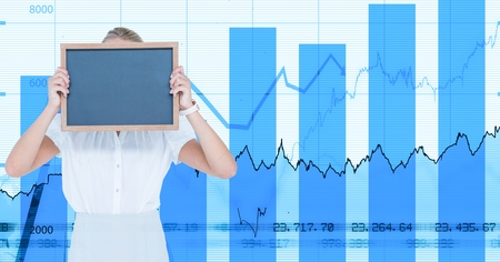 Digital composite of Businesswoman holding blank slate against graph