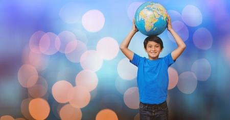 Digital composite of Portrait of boy carrying globe against bokeh