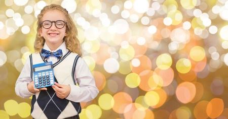 Digital composite of Happy girl showing calculator over bokeh