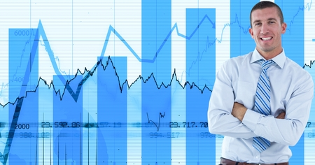 Digital composite of Smiling businessman with arms crossed against graphs