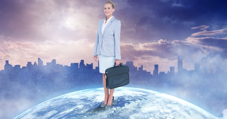 Digital composite of Confident businesswoman standing on globe