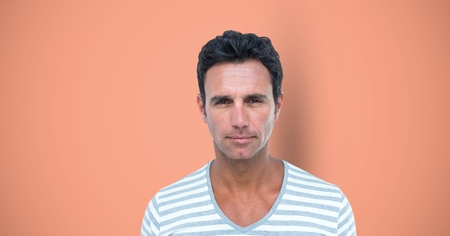 Digital composite of Portrait of confident man over colored background Stock Photo