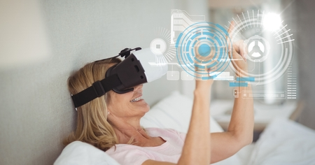 Digital composite of Digital composite image of woman touching futuristic screen while using VR glasses at home
