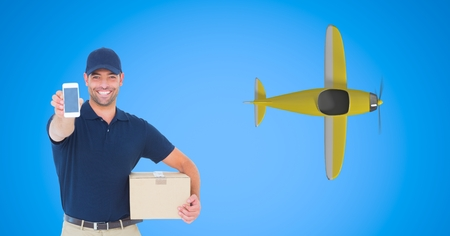 Digital composite of Delivery man showing smart phone with airplane flying in background
