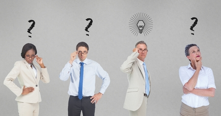 Digital composite of Confused business people with question marks and light bulb on gray background Stock Photo