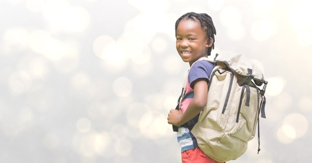 Digital composite of Side view of girl carrying backpack