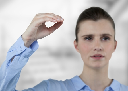 futuristic interior: Digital composite of Businesswoman gesturing while looking away Stock Photo