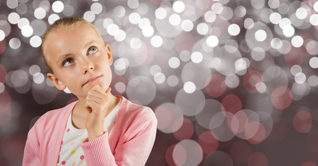 Digital composite of Thoughtful girl with hand on chin over bokeh