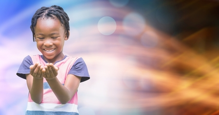 Digital composite of Smiling girl looking at cupped hands over bokeh