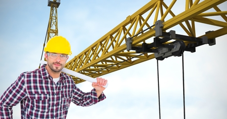 Digital composite of Confident architect holding blueprints by crane Stock Photo