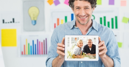 Digital composite of Happy businessman showing man and woman on tablet PCs screen in office
