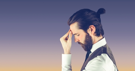 Digital composite of Side view of hippie businessman suffering from headache Stock Photo