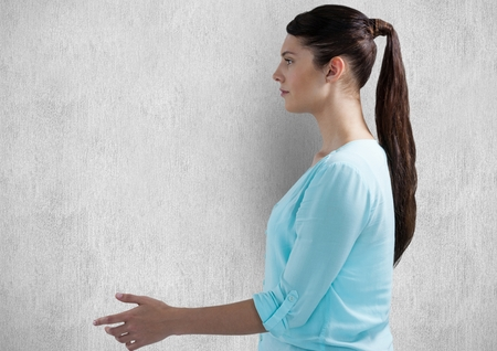 Digital composite of Side view of woman gesturing over wall Stock Photo