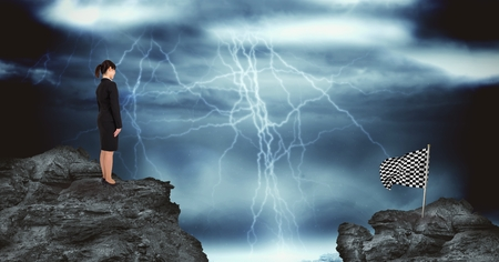 Digital composite of Businesswoman and checked flag over rocks against thunderstorm