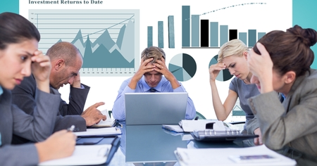 Digital composite of Tensed business people with head in hands against graphs