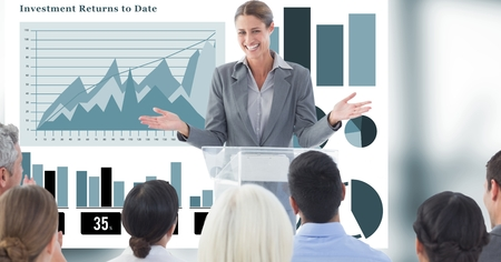 Digital composite of Businesswoman giving presentation to colleagues with graphs in background