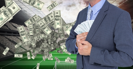 Digital composite of Midsection of businessman hiding money at football stadium representing corruption