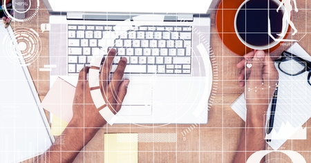 sophisticate: Digital composite of Hands using laptop while holding coffee cup