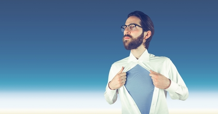 tearing down: Digital composite of Hipster tearing shirt against sky