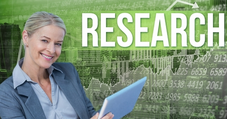 using tablet: Digital composite of Smiling businesswoman holding tablet PC by research text Stock Photo