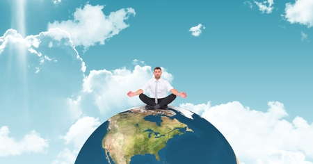 Digital composite of Businessman meditating on globe against sky