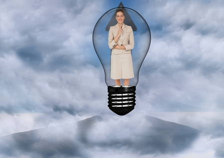 Digital composite of Businesswoman in light bulb surrounded by clouds