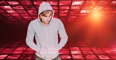 Digital composite of Hipster with hands in hooded shirts pockets against screens