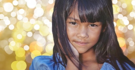raised eyebrow: Digital composite of Close-up of girl with long hair over bokeh