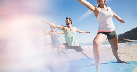 Digital composite of People exercising at beach Stock Photo