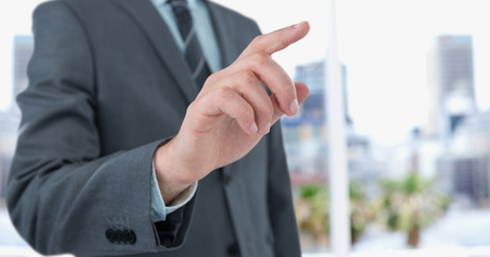 Digital composite of Midsection of businessman touching screen Stock Photo