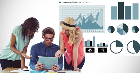 Digital composite of Business people discussing over tablet PC against graphs Stock Photo