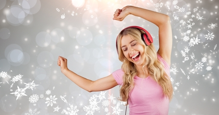 career fair: Digital composite of Happy woman dancing while enjoying music on headphones Stock Photo