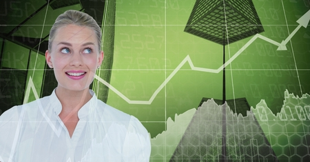 Digital composite of Smiling businesswoman against graphs