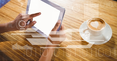 Digital composite of Businessman touching screen of tablet PC by coffee