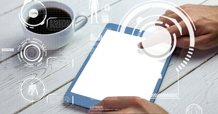 taken: Digital composite of Hand touching screen of tablet PC on table