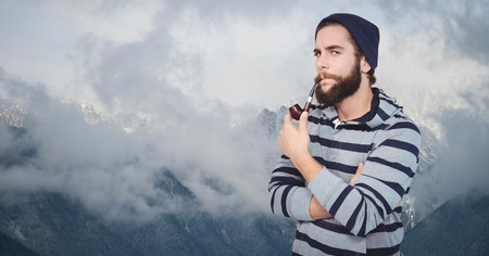 peace pipe: Digital composite of Hipster smoking pipe against mountains