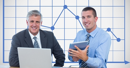swivel: Digital composite of Businessmen smiling while using technologies against graph Stock Photo