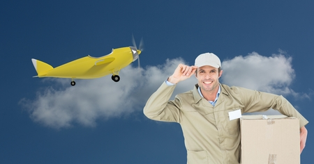 Digital composite of Delivery man carrying parcel against 3d plane