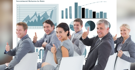 swivel: Digital composite of Business people showing thumbs up against graphs