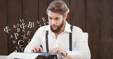 Digital composite of Hipster using typewriter by flying letters Stock Photo