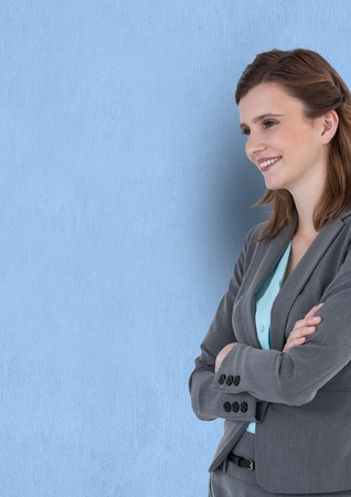 Digital composite of Happy thoughtful businesswoman standing arms crossed against blue background