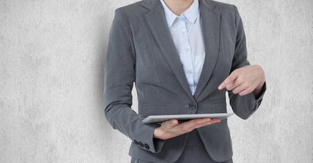 swivel: Digital composite of Midsection of businesswoman pointing at digital tablet