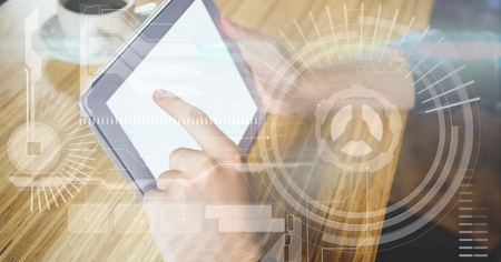 futuristic interior: Digital composite of Hand touching tablet PC with overlays Stock Photo