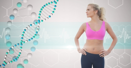 Digital composite of Fit young woman with hands on hips looking at DNA structure