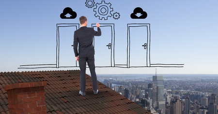 camaraderie: Digital composite of Rear view of businessman drawing doors and gears while standing on roof against sky
