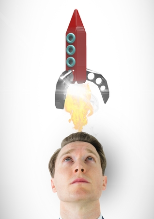thoughtful: Digital composite of Digital composite image of man looking at rocket launch over head against white background