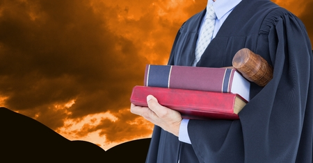 justice scale: Digital composite of Midsection of lawyer holding books and gavel against dramatic sky
