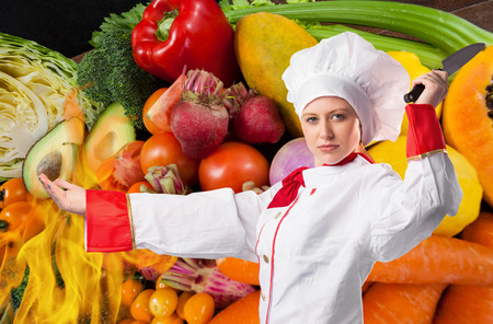Digital composite of chef with fruits background Stock Photo