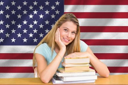 higher intelligence: Digital composite of student against American flag