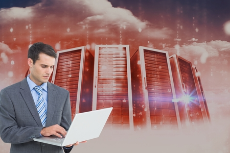 Digital composite of data center with businessman